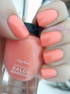 "Sally Hansen: Complete Salon Manicure in ""Peach of Cake"". ""Looking for the most vivid, glossy, upbeat pastel? It's Sally Hansen Complete Salon Manicure in Peach of Cake. (Even the name makes us smile.)"""