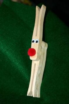 Cute .. and easy .. the kids could do them :) ... Example of the completed clothespin reindeer craft. If you like, you can paint the clothespin brown to make them look more like reindeer.