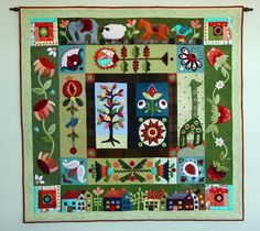 Folk Art Quilt by Cyndi Joslyn, posted at the Quilt Show. A variation of Sue Spargo's 'Folklore' design.