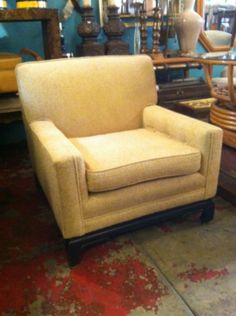 This 1950s Asian-style club chair has square arms and buttoned detailing.