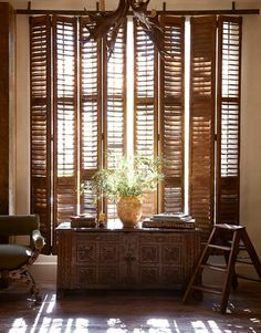 10-foot-tall French shutters hung from metal track to slide open and closed like curtains; Eleanor Cummings