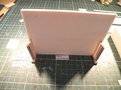 Miniature Piano workshop. Step no. 6  Paste the piano legs to the front board as shown on the picture.