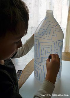 Draw a maze on a large plastic bottle. Put a magnet inside and have the child use another magnet to get the inside magnet out following the maze.