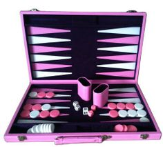 """Sophia 18"""" Vinyl Backgammon Set in Pink by Best Chess Set. Save 13 Off!. $64.95. board style: pink attache case with purple interior and 2 silver lock accent and a handle. also available in other sizes: 9, 12 and 15 in. (SOLD SEPARATELY). comes complete with 2 pink dice cups and pink and white dice. board dimensions: 22.5x18x1 in. (open), 18x11x2 in (folded). pink and white backgammon pieces diameter: 1.25 in.. Backgammon is a board game for two players in which the playing pieces are…"""
