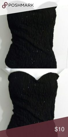 Black sparkly strapless top Black sparkly strapless top gently used still in great conditions great for an outing looks very cute. Janice  Tops