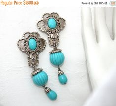 JOSE BARRERA for Avon Earrings. Very Pretty and easy to wear ! Silvertone finish with aqua lucite cabocons and beads. Hallmarked BARRERA for AVON on the reverse. 3 inches long. Snug clips. Clean ready to wear.  All items are preowned and show signs of use and previous ownership. Items are in good wearable vintage condition unless stated otherwise. Please convo with questions.  Review policies prior to purchase  ***************************SHIPPING********************************  DOMESTIC…