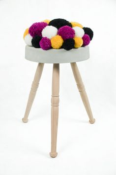 Pom-poms three legged #stool made of #wood, #concrete and a #wool #cushion / Design by 441 Design Studio