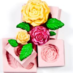 Silicone Rose Mold Set Includes 3 Rose Molds and 1 Leaf Mold.    (1) Large Cabbage Flower Rose Mold creates a rose that measures: 1 & 9/16ths inch
