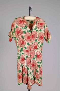 1940s playsuits were very popular. often times they were jumpers that could have a shirt tide over it. Sometimes they were military styled. Went with the idea that women need to be mobile and able to work.