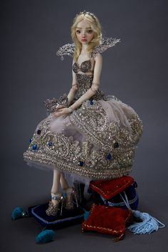 This is as close as I will get to owning one of this artists work.  There are 6 days left in the auction and the last bid was $30,100.    She has a sterling silver crown, collar, corset, masque and shoes.  Magnetic wig, embroidered gown and is a porcelain, ball-jointed doll.  Just gorgeous!  Cinderella Porcelain Enchanted Doll BJD   eBay