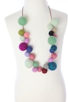I made a colorful neck-piece with right felt balls.  It is perfect for the Spring / Summer season!    Made by hand (with love) in Tokyo :)