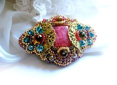 Madame Elegant Bead embroidered brooch with pink Rodochrosite. $80.00, via Etsy.