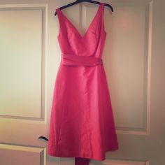 J.Crew dark pink dress J.crew dark pink 100% cotton dress with silk sash that tied around waist. Dress hits at knee with the same v-neck in the back as the front. J. Crew Dresses