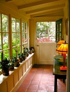 Delightful Green Plants Pottery On Windows Shelves As Well As Antique Shade Table Lamps As Decorate In Small Beautiful Enclosed Porch Ideas
