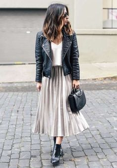 Black leather jacket over white tee and soft taupe pleated midi skirt. #reloj #michaelkors #mujer #michaelkorsperu #peru