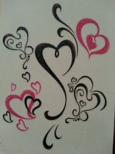 Heart tattoos - the one in the middle cause it looks like a B.