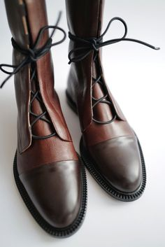 Finely handcrafted from the softest Italian textural pebble-grain leather finished with black glossed toe straps and a modern lace-up front fastening these boots are packed with modern urban… Brown Leather Ankle Boots, Leather Brogues, Leather And Lace, Leather Shoes, Baskets, Fashion Shoes, Hijab Fashion, Me Too Shoes, Stiletto Heels