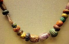 Merovingian glass and amethyst beads 7th century