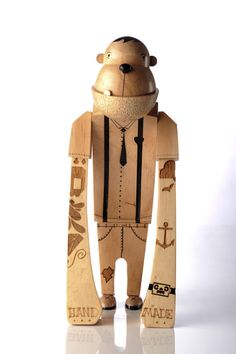 hand-made wooden character by Rowan Toselli