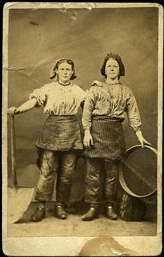 Women were forbidden to go down the mines in Victorian times, but could be employed in equally heavy industry on the pit face. These two were from Wigan, England and photographed in a studio wearing work clothes c1860