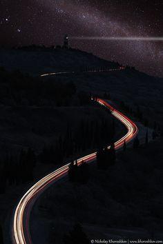"""Lighthouse and traffic lights over starry sky"" by Nickolay Khoroshkov, via 500px."