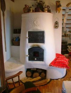 this wood stove fireplace. Rocket Heater, Rocket Stoves, Cob Building, Building A House, Earth Bag Homes, Four A Pizza, Outdoor Oven, Cooking Stove, Stove Fireplace