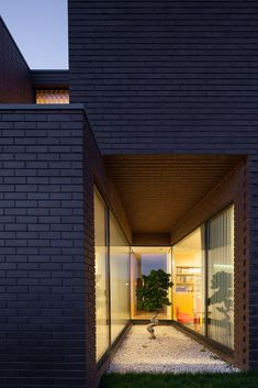 Image 17 of 32 from gallery of House in Agra / RVdM Arquitecto. Photograph by José Campos Agra, Brick Courtyard, Brick Facade, Brick Houses, Solid Brick, Black Brick, Sauna House, Alvar Aalto, Facade Design
