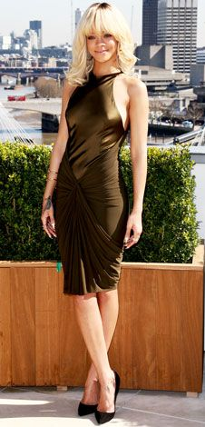 03/29/12: The London skyline has nothing on this architectural ensemble! #Rihanna played up her figure in a draped olive design. http://www.instyle.com/instyle/celebrities/lotdpopup/0,,20582743_21140295,00.html