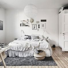 Scandi bedroom. Great contrast and a feel for wood. #interior #furniture #bedroom #bed #bedside #wallart