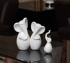 http://i00.i.aliimg.com/wsphoto/v0/2039517438_1/Modern-Fashion-font-b-Porcelain-b-font-font-b-Elephant-b-font-Family-font-b-Figurine.jpg