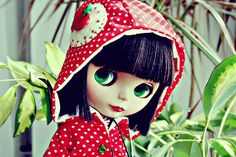 Blythe in a red raincoat
