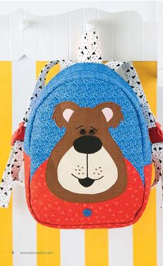 Woodland Creatures Backpacks - Woodland Creatures Backpacks from Leisure Arts presents five cute appliqued bags by Sue Marsh for Whistlepig Creek Productions. Great for kids to carry school gear or take on a sleepover, the fun designs depict Filomena Fox, Fitzgerald Frog, Bryson Bear, Thomas Turtle, and Olympia Owl. Each zippered backpack features a patchwork of colorful fabrics, and some include dimensional accents such as tails, feet, wings, or ears. The finished size of each bag is 9.5 x…