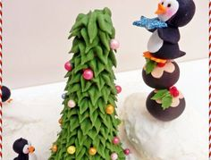 The Christmas tree is actually an ice cream cone that I have piped with Royal Icing. Figures are made out of fondant.