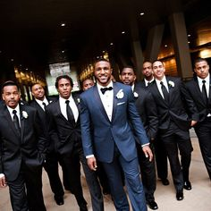Ryan wore a handsome navy tux with a black bow tie, while the groomsmen all looked classic in black tuxedos and ties. Description from pinterest.com. I searched for this on bing.com/images