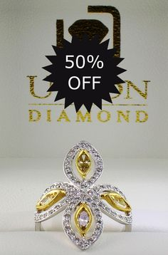 TODAY ONLY - 18K white and yellow gold floral ring containing 1.10 carats in fancy yellow and white marquise and round brilliant cut diamonds. Regularly $4710.00 - today only, $2355.00. Reference #36214, while in stock. UnionDiamond.com.