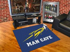 """University of Toledo Man Cave All-Star Mat 33.75x42.5 - Decorate your home, office, or tailgate with area rugs by SPORTS LICENSING SOLUTIONS. Made in U.S.A. 100% nylon carpet and non-skid recycled vinyl backing. Officially licensed and chromojet printed in true team colors.FANMATS Series: MCaveAll-StarTeam Series: University of ToledoProduct Dimensions: 33.75""""x42.5""""Shipping Dimensions: 34""""x23""""x1"""". Gifts > Licensed Gifts > Ncaa > All Colleges > University Of Toledo. Weight: 3.40"""
