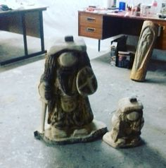 Clans men chainsaw carved