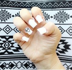 White nails with alien design
