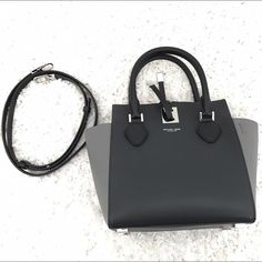 Michael Kors Collection : Miranda Black & Grey Soft Calf Leather from Michael Kors Limited Edition Collection. Suede interior. Long strap included. Black Front & Back & Light Grey sides. Silver Accents as seen in interior picture, not gold. NEW still in wrap. Purse needs to be used to get soft shape. Michael Kors Bags Shoulder Bags