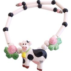 You are hanging out at a country farm when you wear this fun, Flying Colors ceramic necklace that features a black and white cow, complete with its