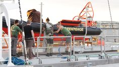 Crew of the Rainbow Warrior work on the inflatables on board (c) Greenpeace / Sarah Yates Rainbow Warrior, Sailing, Around The Worlds, Australia, Ship, Board, Candle, Ships, Planks