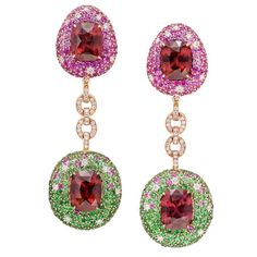 """The most fabulous Zircon surrounded by pink Sapphires and glistening Tsavorite. Such happy earrings. Zircon has a very high refractive index which makes it amongst the sparkliest of gems and we do like our gems sparkly don't we!! This is a pair of """"attitude adjusting earrings"""" - for sure as soon as you don them whatever you might be thinking it will become a happy thought! 🌴#margotmckinneyjewellery"""