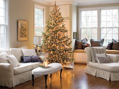 Warm Tones *******************************************    An all-gold Christmas tree makes this all-white living room cozy and warm.