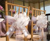 Chair bows add a romantic touch.