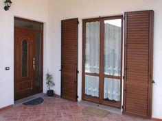 Portone e porta finestra con persiana