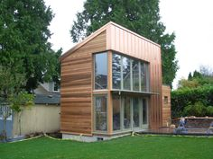 A beautifully designed tiny house. The pavilion is constructed mostly of copper, glass and cedar and has a 12' by 25' footprint with a double-height main room and a full bathroom to one side.