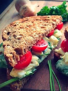 Whole wheat toast with homemade eggsalad on a bed of spinach, topped with cherry tomatoes