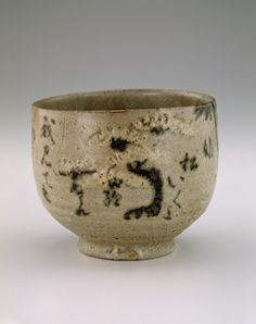 Kyoto ware tea bowl inscribed with poem about Sumiyoshi Shrine  18th-19th century      Edo period     Stoneware with white slip and iron pigment under translucent wood-ash glaze; gold lacquer repairs  H: 9.2 W: 11.3 cm   Kyoto, Japan