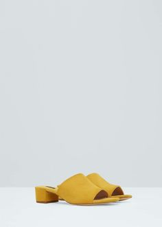 We love the cheerful yellow color of these leather sandals.