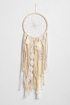 Make dreamcatcher with trims & ribbons instead of feathers and braided ring.